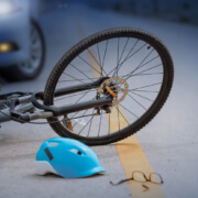 What should a bicyclist do after being injured by a negligent driver in West Virginia?