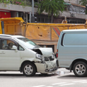 What happens if an individual is involved in a car accident while on the job?